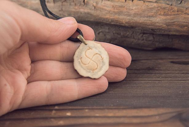 символ бога рода